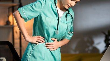 Krankenschwester Krankenhaus Belastung Rücken Schmerzen Stress Frau Pflege